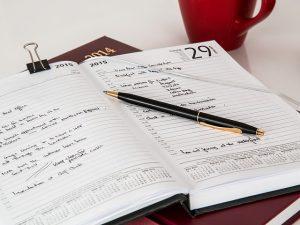 A schedule in a notebook.