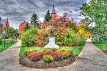 University of Vermont amazing garden, with two pathways and a statue,
