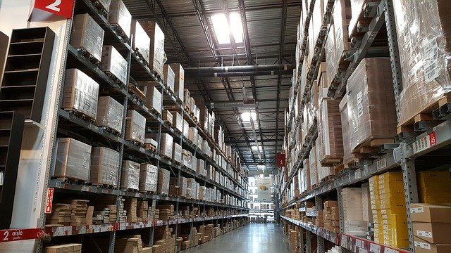 Large warehouse with shelves full of boxes and items on both sides