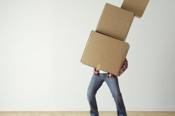 A man choose the right moving boxes and carrying them.