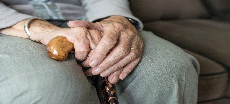 a senior holding a cane