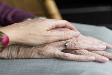 two senior holding hands in one of housing options for the elderly