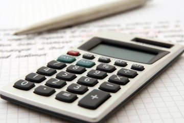 calculator and a pen to help you get a precise moving estimate