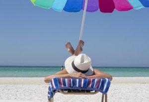 A girl lying on the beach.