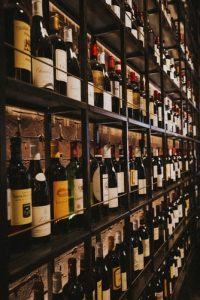 A wine collection displayed on large shelves.