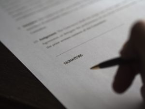 A person getting ready to sign a contract.