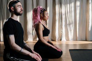 Two people doing yoga