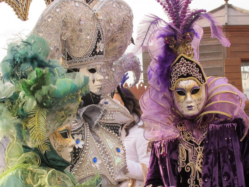 People with carnival masks