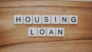 Housing loan spelled out in white blocks with black letters on top.