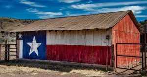Texas flag painted on a barn in one of the Small Texas cities that are becoming popular among millennials