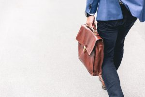 A man holding a purse. Moving to Thornton CO will provide you with some neat job opportunities.