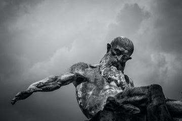 A sculpture of an old man with a beard